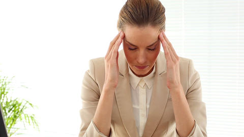 Businesswoman with a bad headache Footage