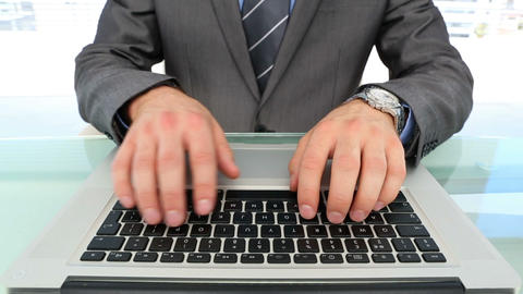 Businessmans hands typing on laptop Footage