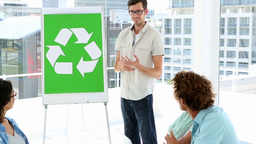 Man present environmental awareness plan to colleagues Footage