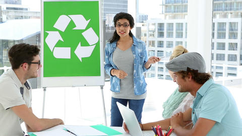 Woman presenting environmental awareness plan to colleagues Footage