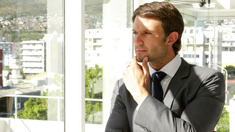 Thoughtful businessman looking out window Footage