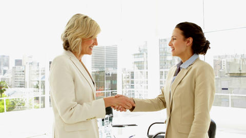 Happy businesswomen shaking hands Footage