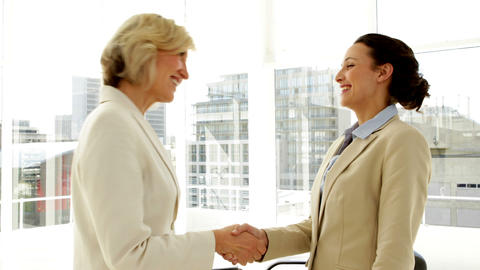 Smiling businesswomen shaking hands Footage