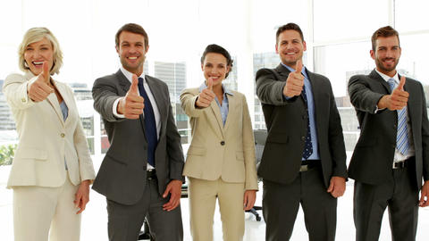 Business people giving thumbs up Footage