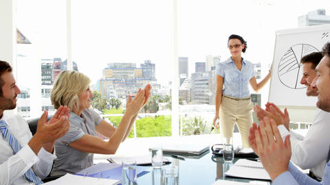Businesswoman giving presentation to colleagues Footage