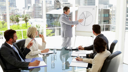 Businessman giving presentation to colleagues Footage