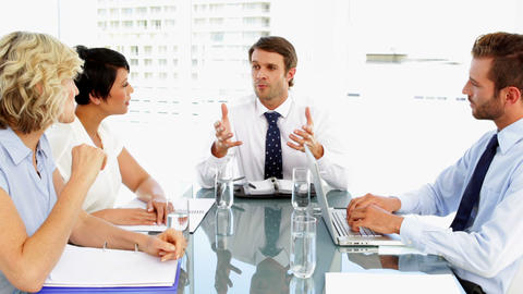 Business people listening to their boss during meeting Footage