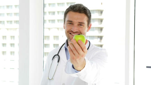 Doctor holding a green apple Footage