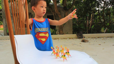 Boy play the traditional toys in Asia made by colored rice powder Footage
