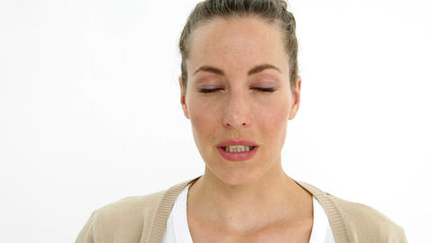 Sick ponytailed woman sneezing Footage