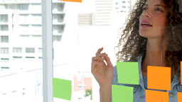 Young female designer brainstorming Live Action
