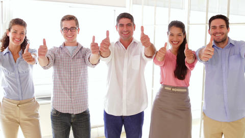 Content creative team showing thumbs up Stock Video Footage