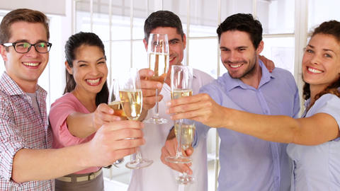 Gleeful designers celebrating with champagne Stock Video Footage