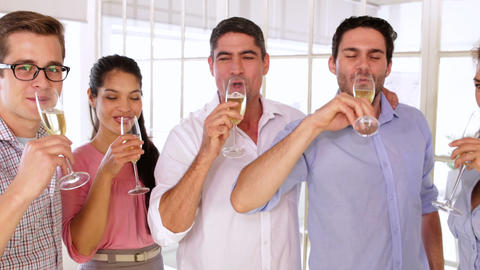 Gleeful Designers Celebrating With Champagne stock footage