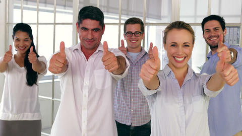 Team Of Creative Designers Showing Thumbs Up stock footage