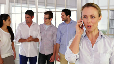 Female designer phoning before posing Stock Video Footage