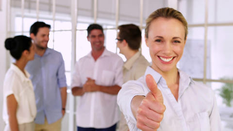 Attractive blonde businesswoman showing thumbs up to camera Stock Video Footage