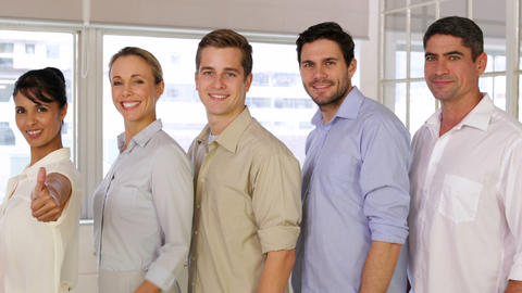 Attractive businesspeople posing showing thumbs up Stock Video Footage