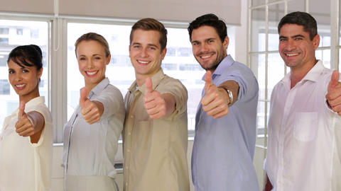Attractive businesspeople posing showing thumbs up Footage
