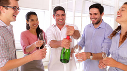 Cheerful colleagues celebrating with champagne Stock Video Footage