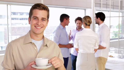 Attractive young businessman posing holding a mug Stock Video Footage
