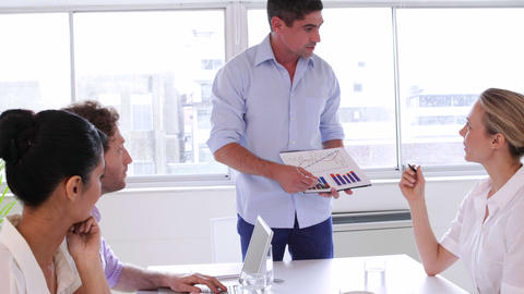 Businessman presenting chart to business team Stock Video Footage