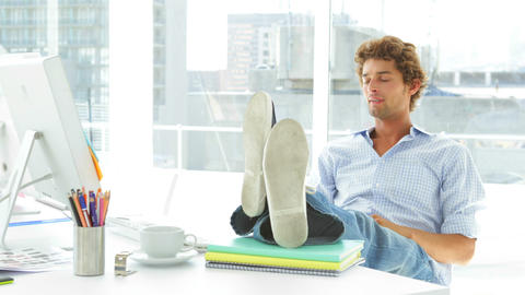 Relaxed businessman reclining on his swivel chair Stock Video Footage