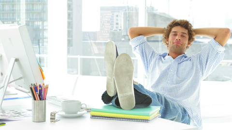 Relaxed businessman reclining on his swivel chair Footage