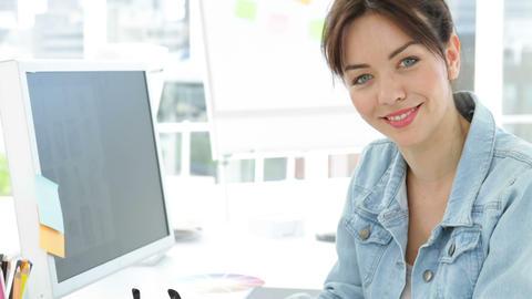Beautiful smiling creative designer working sitting at... Stock Video Footage