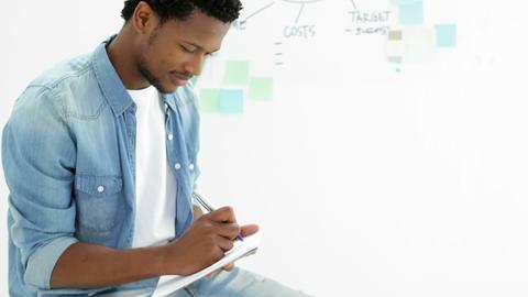 Focused creative designer working on his tablet Stock Video Footage