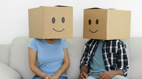 Silly employees with boxes on their heads Stock Video Footage