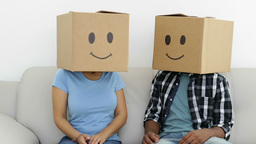 Silly employees with boxes on their heads Footage