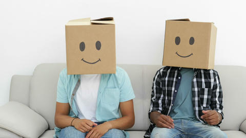 Silly employees with boxes on their heads giving thumbs up Footage