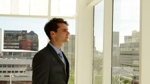 Businessman looking out his window Footage