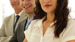 Business team smiling at camera with arms crossed Stock Video Footage