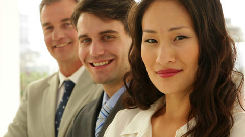 Business team smiling at camera with arms crossed Footage