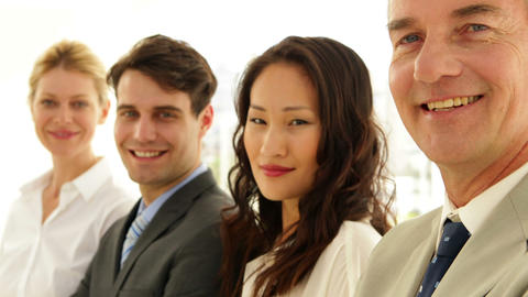 Business team smiling at camera with arms folded Footage