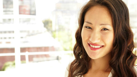 Asian businesswoman smiling at camera Stock Video Footage
