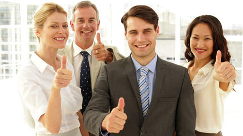 Business team giving thumbs up to camera Stock Video Footage