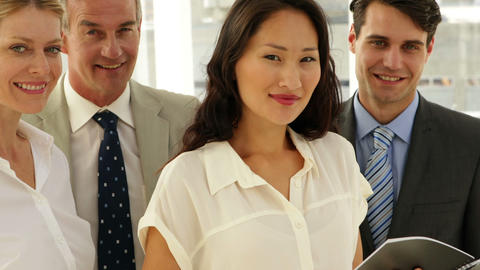Business team smiling at camera Stock Video Footage