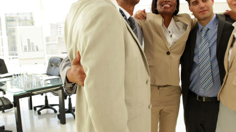 Business people embracing each other Stock Video Footage