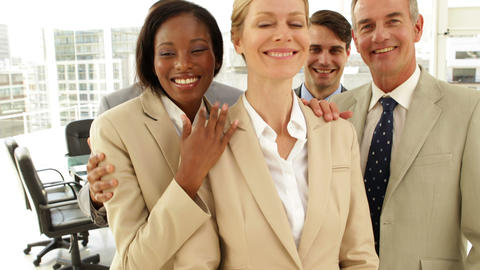 Business people hugging each other Stock Video Footage