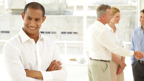 Businessman smiling in front of his staff Stock Video Footage