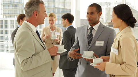 Business people chatting at a conference having coffee Stock Video Footage