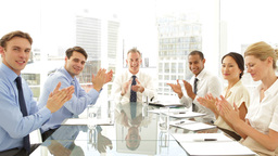 Business people clapping at presentation at the camera Stock Video Footage