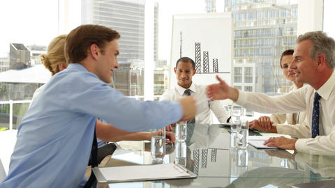 Business people shaking hands at a meeting Stock Video Footage