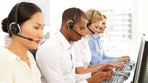 Call centre agents working Stock Video Footage