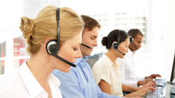 Call centre agent on a call Stock Video Footage