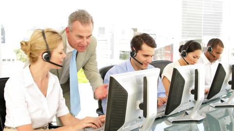 Manager checking in on call centre employees Stock Video Footage
