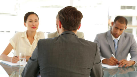 Businessman being interviewed by panel Stock Video Footage
